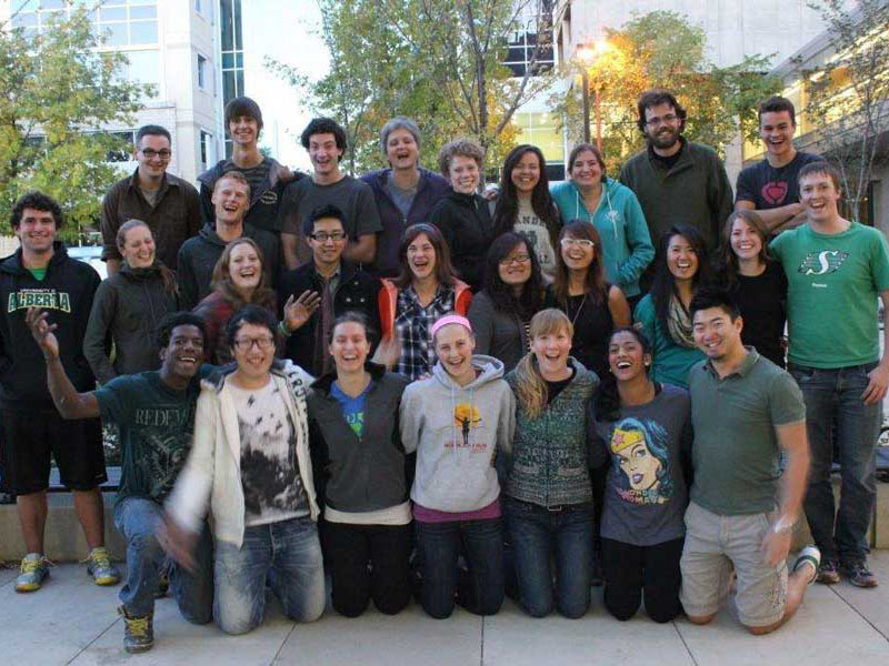 University of Alberta undergraduate students posing for a group picture on campus with campus staff
