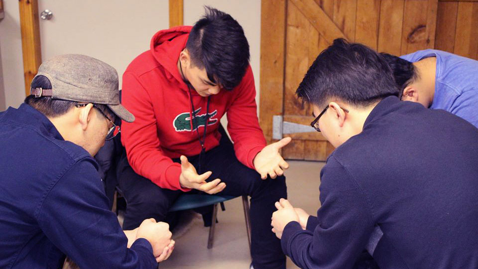 University of Toronto students praying together