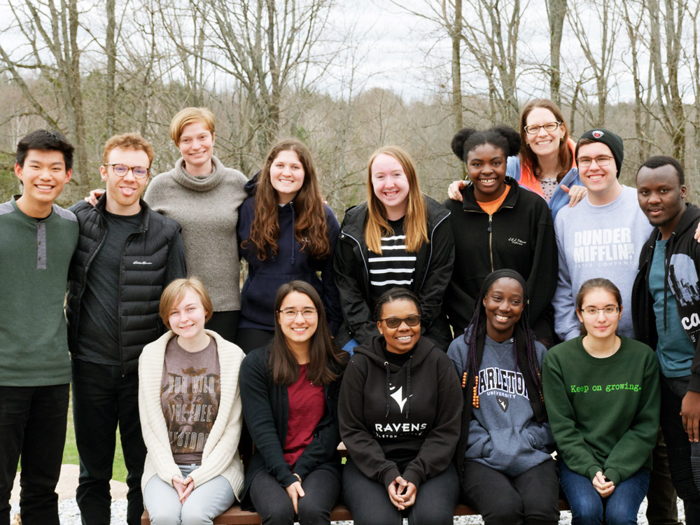 Carleton students and campus staff in a group photo