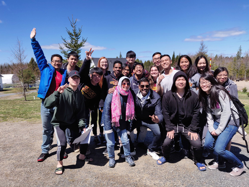 Students at Concordia University posing for a group picture with campus staff