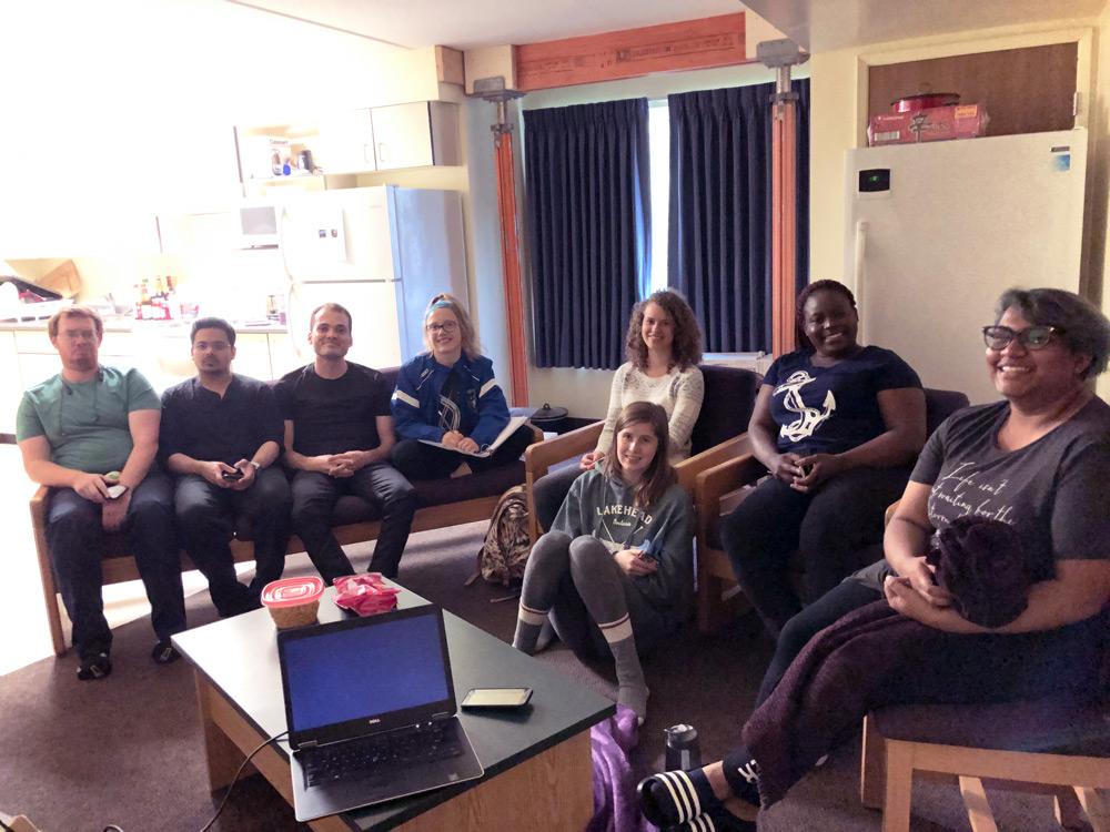 Lakehead University students sitting together