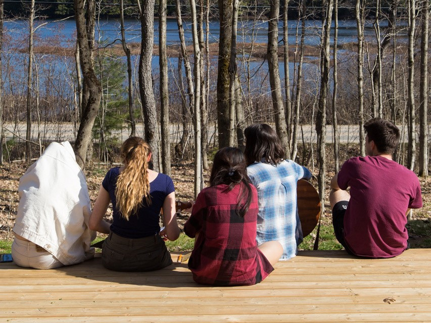 McMaster University students sitting together outside