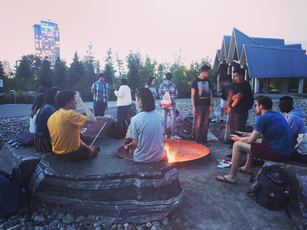 Ryerson University students sitting around the fire