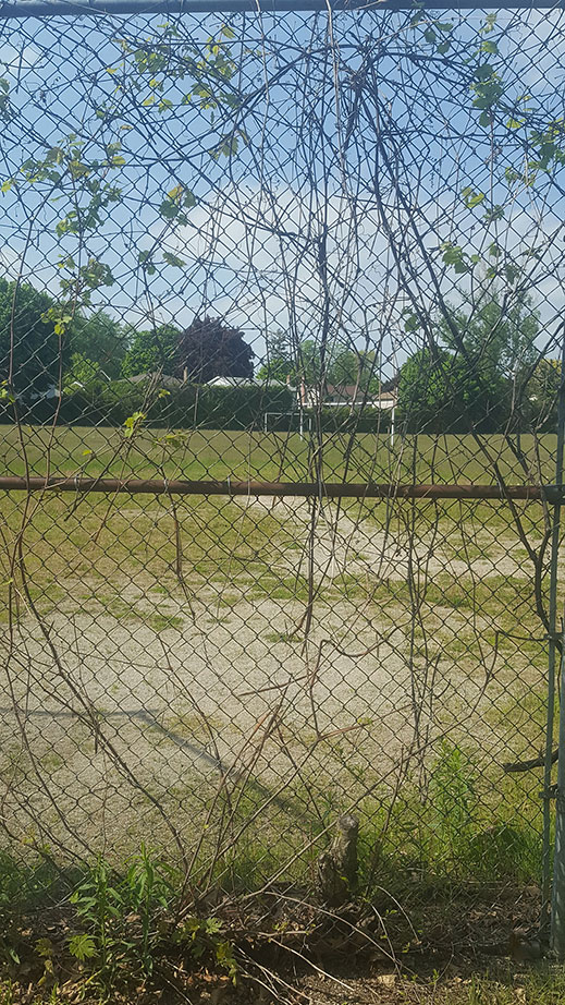 A photo of a fence placed around a soccer field