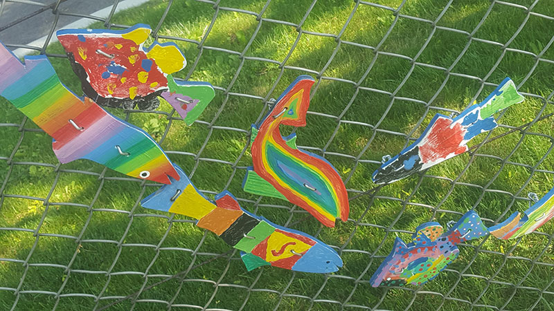 A photo of rainbow-coloured and fish-shaped decorations