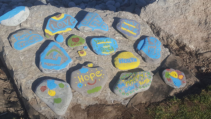 A photo of colourfully decorated stones