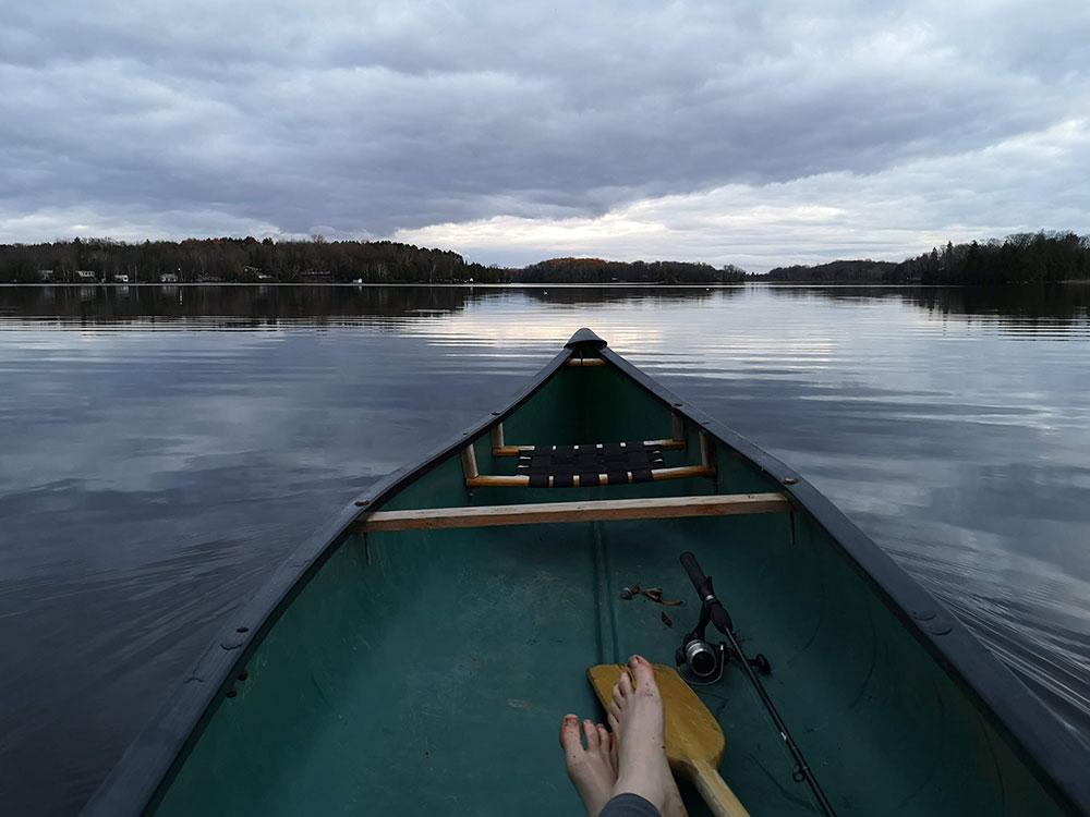A photo of a canoe boat on a lake