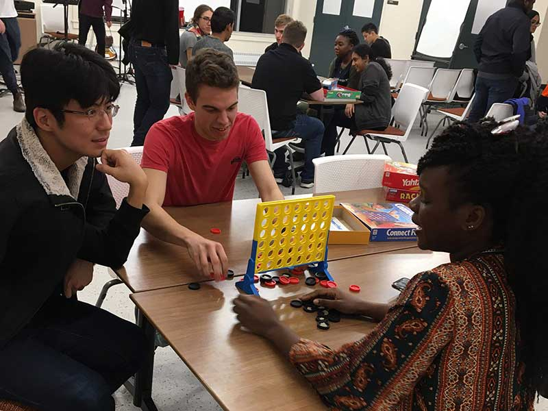 Memorial University students playing board games together