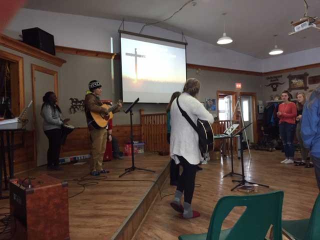 Undergraduate students at Western University worshipping