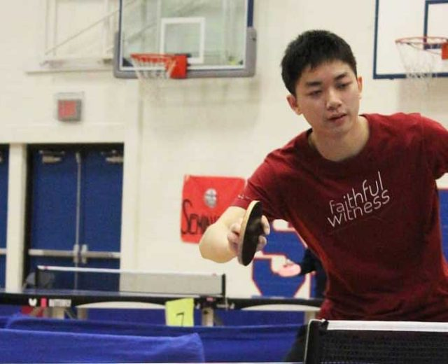 Photo of the student author of this article playing table tennis