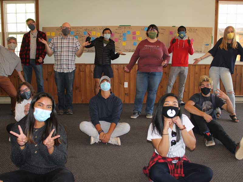 University of Manitoba students posing for a group picture while distancing and wearing masks