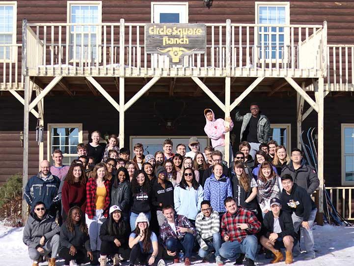 University of Manitoba students taking a group photo at a Circle Square Ranch camp
