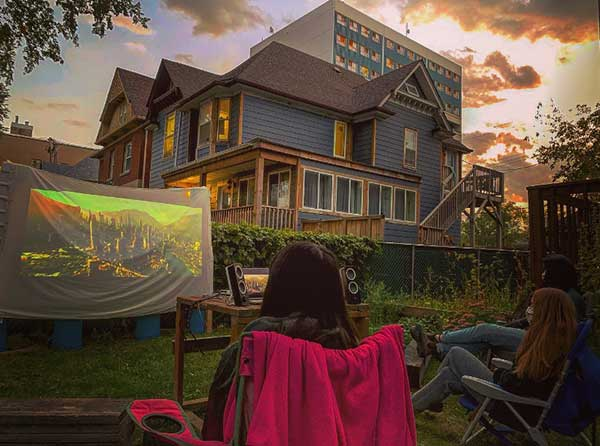 University of Winnipeg student group gathered to watching a movie in the backyard